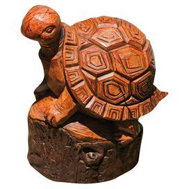 """Showcasing a turtle silhouette and wood-inspired finish, this charming statue adds lovely style to your garden or front porch decor.  Product: StatueConstruction Material: ResinColor: BrownFeatures: Turtle designDimensions: 7.09"""" H x 9.06"""" W x 5.12"""" D"""