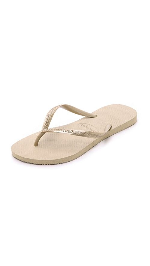 Havaianas Slim Flip Flops | These rubber flip-flops feature 'Havaianas' lettering at the thin strap. Fabric: Rubber. Imported, Brazil. Measurements |  Platform: 0in / 1.5mm