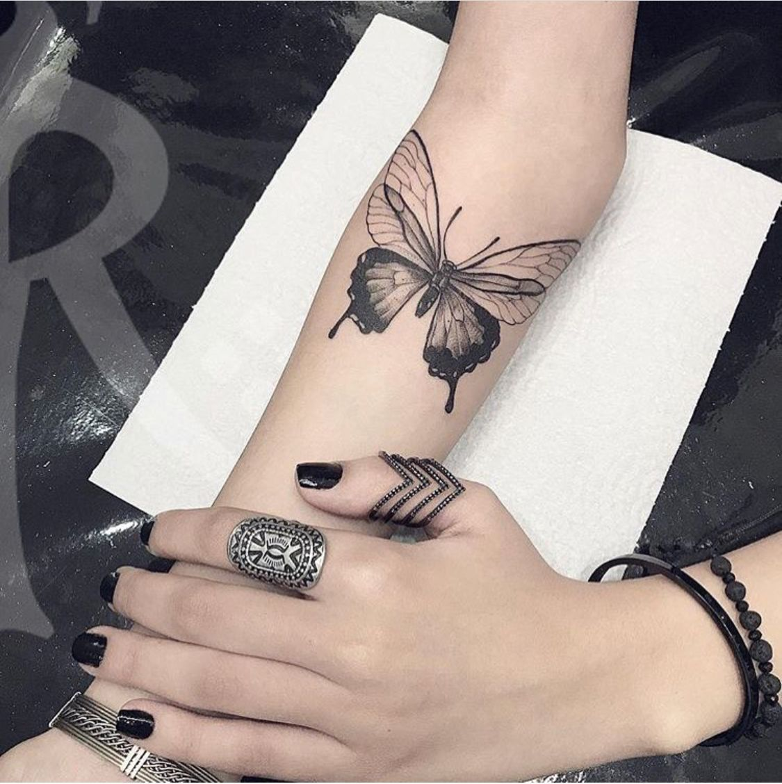 Photo of butterflies and flowers tattoo