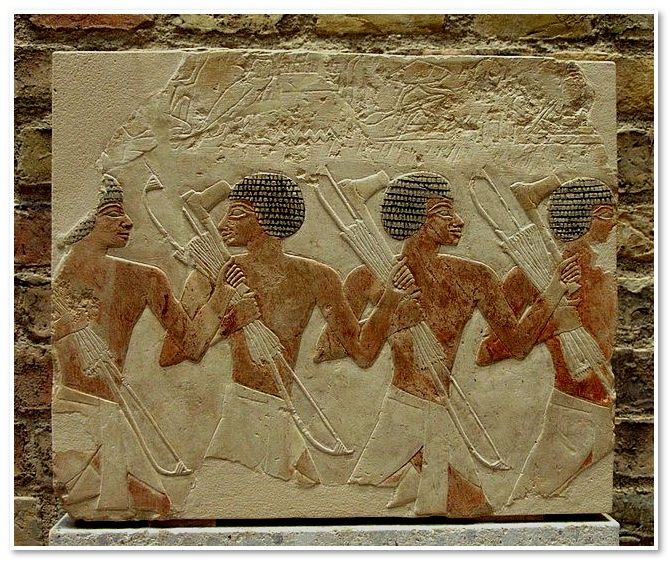 Fragment of a relief : Nubian mercenaries  From Deir el-Bahri, Western Thebes.  18th dynasty, 1479-1458 BC.  Limestone.