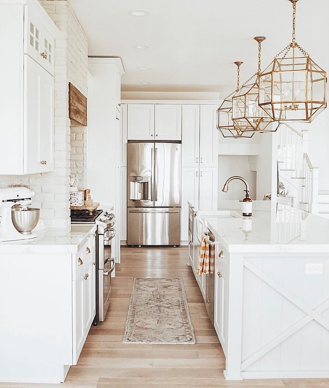 white kitchen with champagne bronze fixtures and brass
