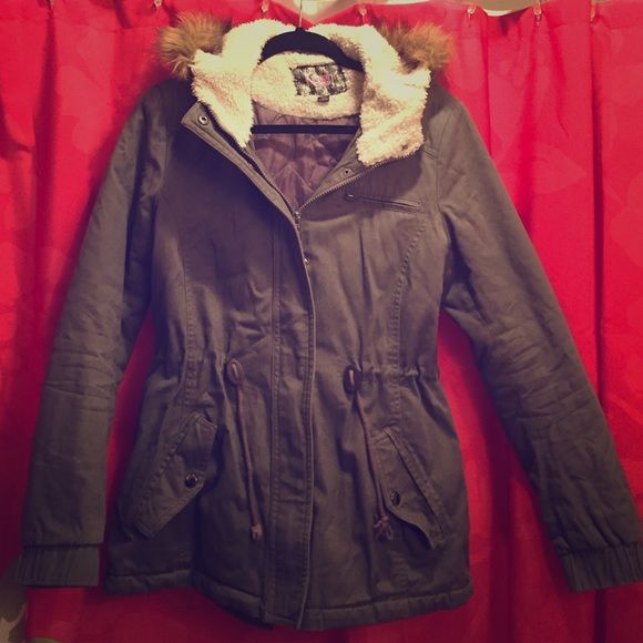 Coat Grey juniors size large coat. Faux fur on rim of hood not removable. Very warm :) Worn last winter and just got a new one this year. No flaws or stains. Waist can be tightened. Small pocket up above is not actually a pocket just a zipper. Make me an offer :) Jackets & Coats