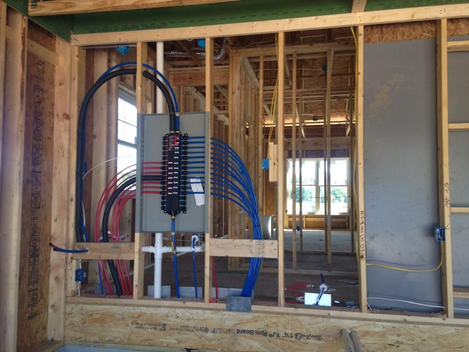 Close Up Of The Manabloc Plumbing System In A New House In Fox Haven Energy Efficient Homes Pex Plumbing Plumbing