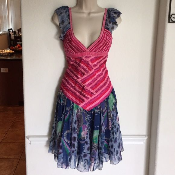 Colorful Salsa Dress Gorgeous colorful salsa dress. Torso part is an very stretchy hugging material. The blue material is very flowy and wavy Dresses