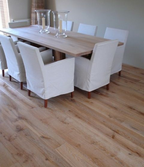 distressed wood laminate flooring sparse serene dining room - Dining Room Flooring Options