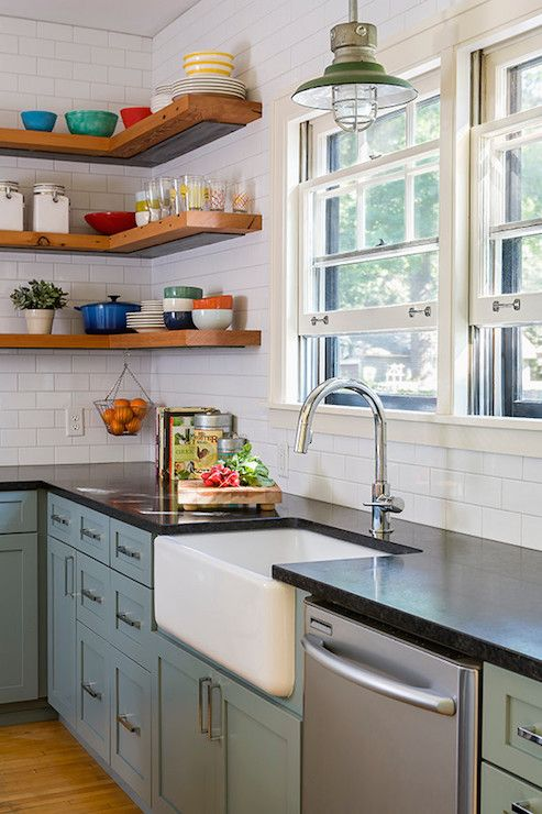 Ordinaire Vintage Kitchen Design Features Slate Blue Base Cabinets Accented With  Sleek Polished Nickel Hardware Topped With Honed Black Granite Countertops  Under ...