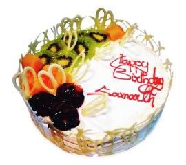 The cake with fresh fruit topping nicely designed with white
