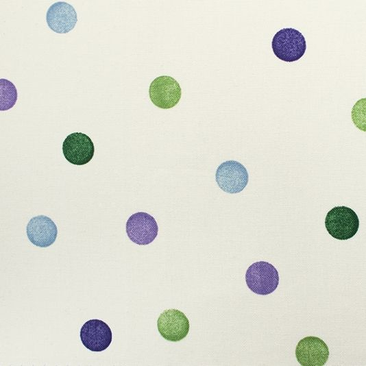 Polka Dot Fabric A curtain fabric designed by Emma Bridgewater printed with her timeless classic Polka Dot design in purple, lilac, green and blue on a pale cream ground.