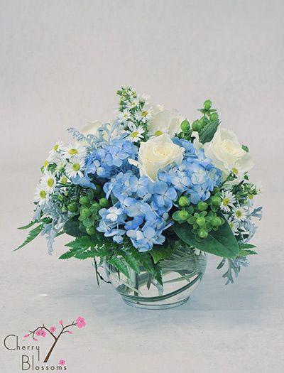 Blue and white centerpieces cherry blossoms florist