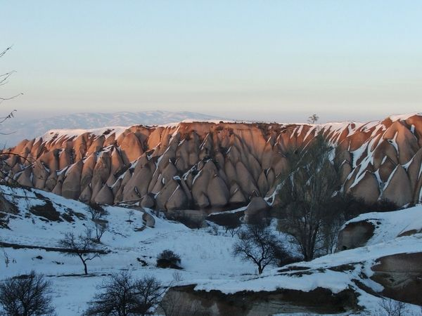 The sun gives the weird hills in #Cappadocia, #Turkey an orange glow.