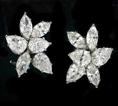 13 cts. t.w. diamond cluster earrings to the 84th Academy Awards   Cluster earrings in platinum have 13 cts. t.w. diamonds; $120,000. Norman Silverman