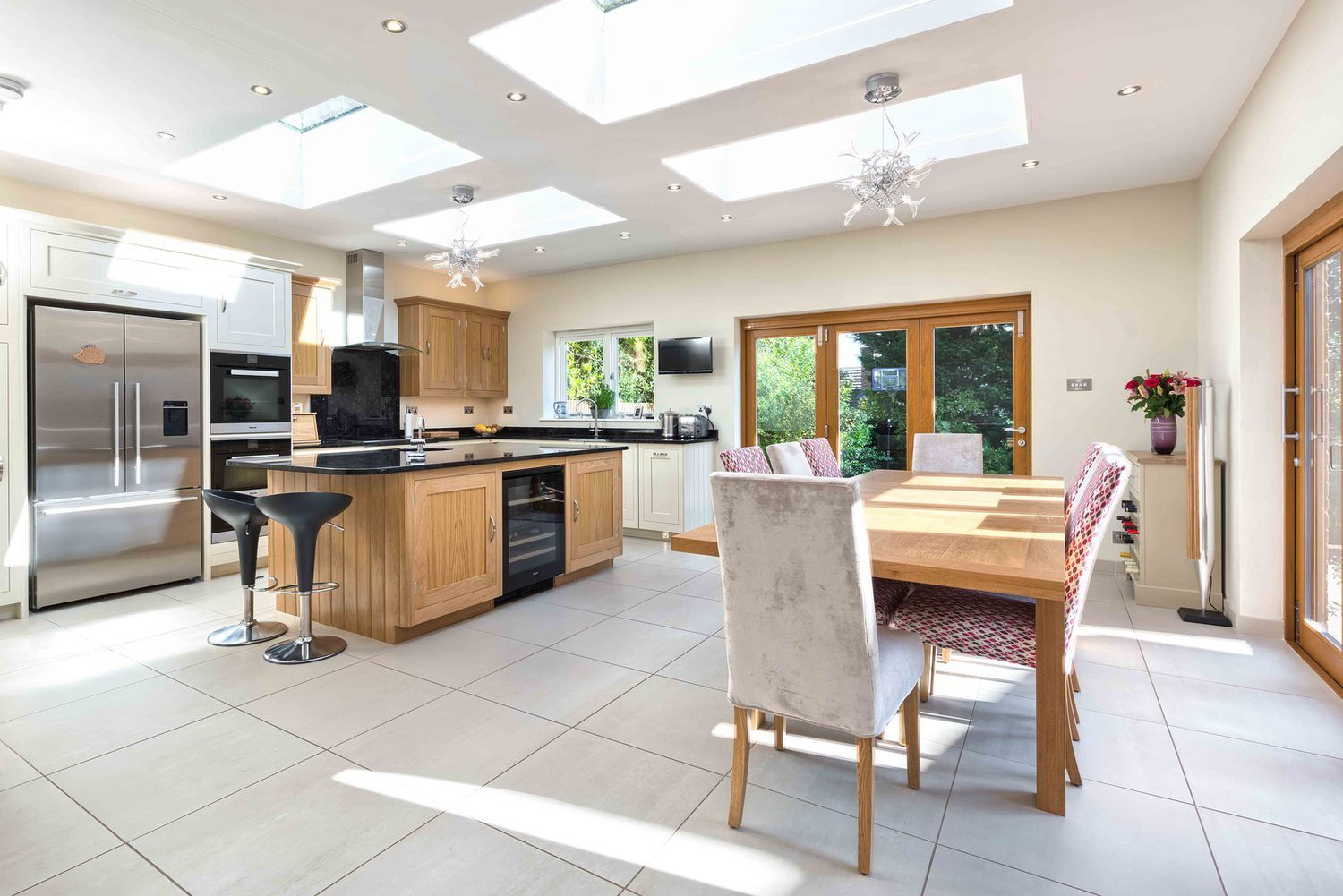 A dining room and kitchen with a skylight of a modern ...