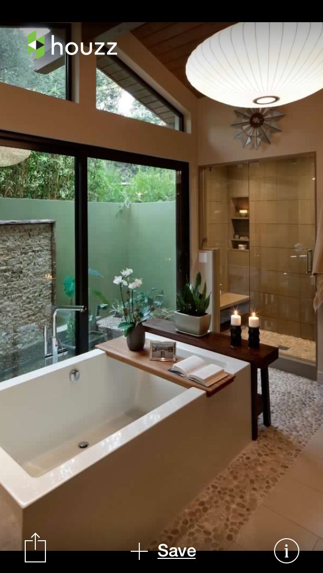Enclosed shower stall bathtub window and looks like outdoor shower ...