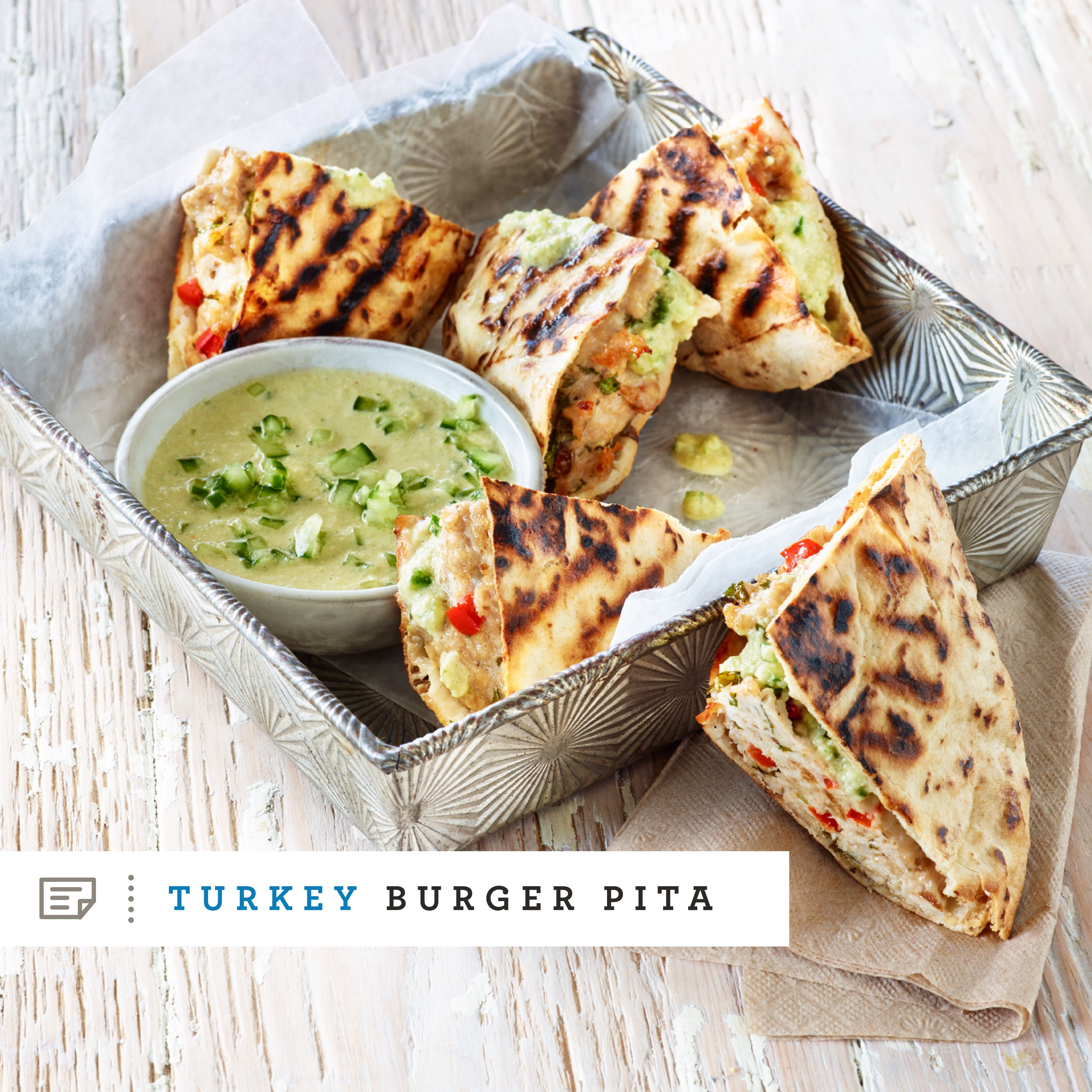 A filling lunch you can feel good about. Turkey Burger Pita gets a zesty zing from lemon and tahini.