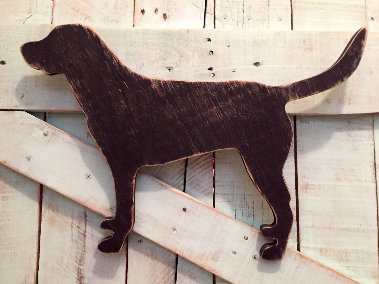 A personal favorite from my Etsy shop https://www.etsy.com/listing/216564593/distressed-black-lab-silhouette-wall