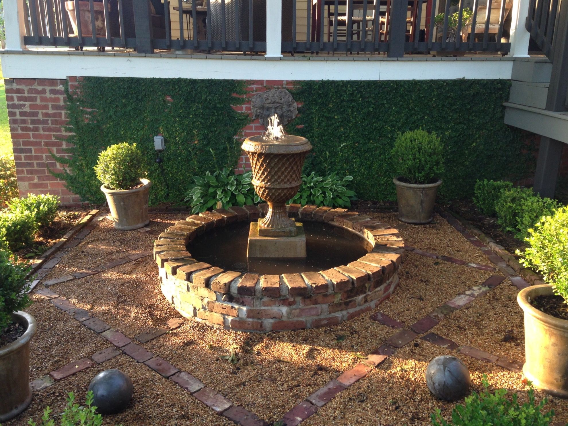 Brick Grid With Pea Gravel Around Garden Fountain Home Landscaping Garden Design Garden Inspiration
