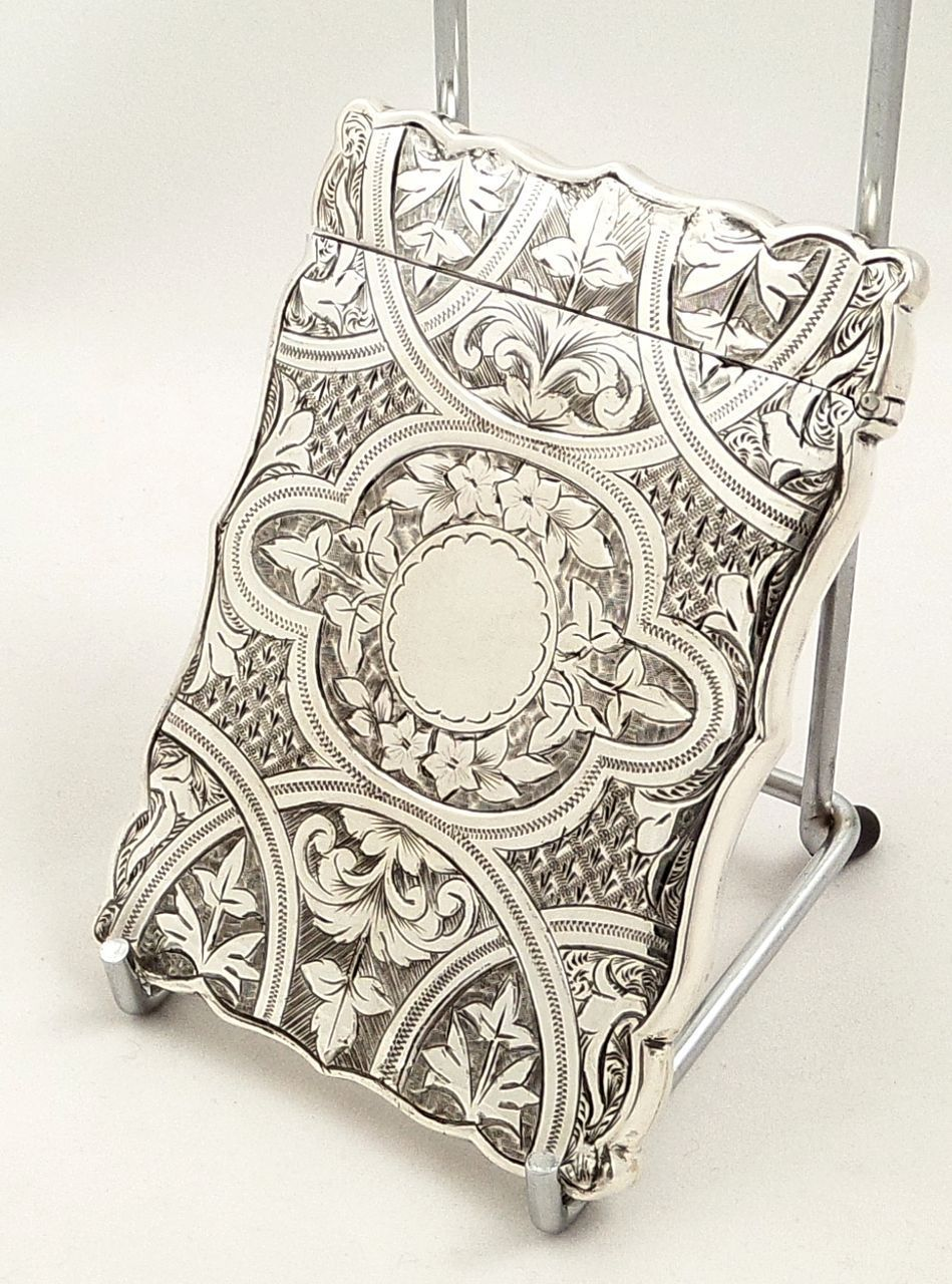 This is a beautiful antique solid sterling silver card case measuring 3 1/2 (9 cms) tall x 2 1/2 (6.5 cms) wide with lovely engraved decoration and in