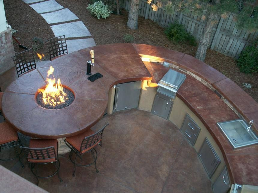 beautiful outdoor kitchen combined with a fire pit on a bar top table wow what a great feature on outdoor kitchen kegerator id=81764