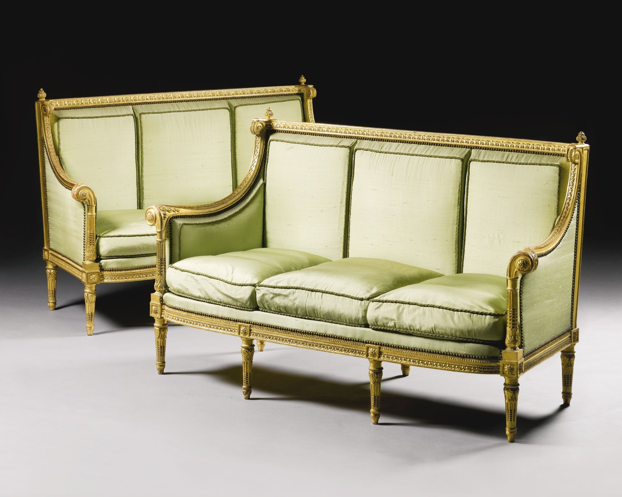 A pair of carved giltwood canap s attributed to georges for Canape directoire