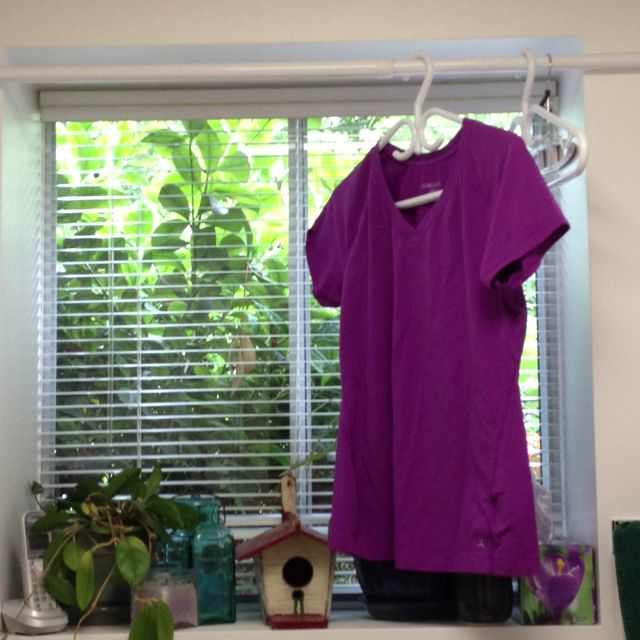 Spring loaded shower curtain rod over laundry room sink to hang ...
