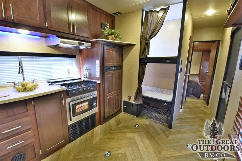The Vengeance 28v Is A Travel Trailer Toy Hauler With Bunk Beds It
