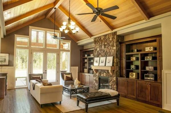 Lodge style living room with with vaulted wood beam ceiling House