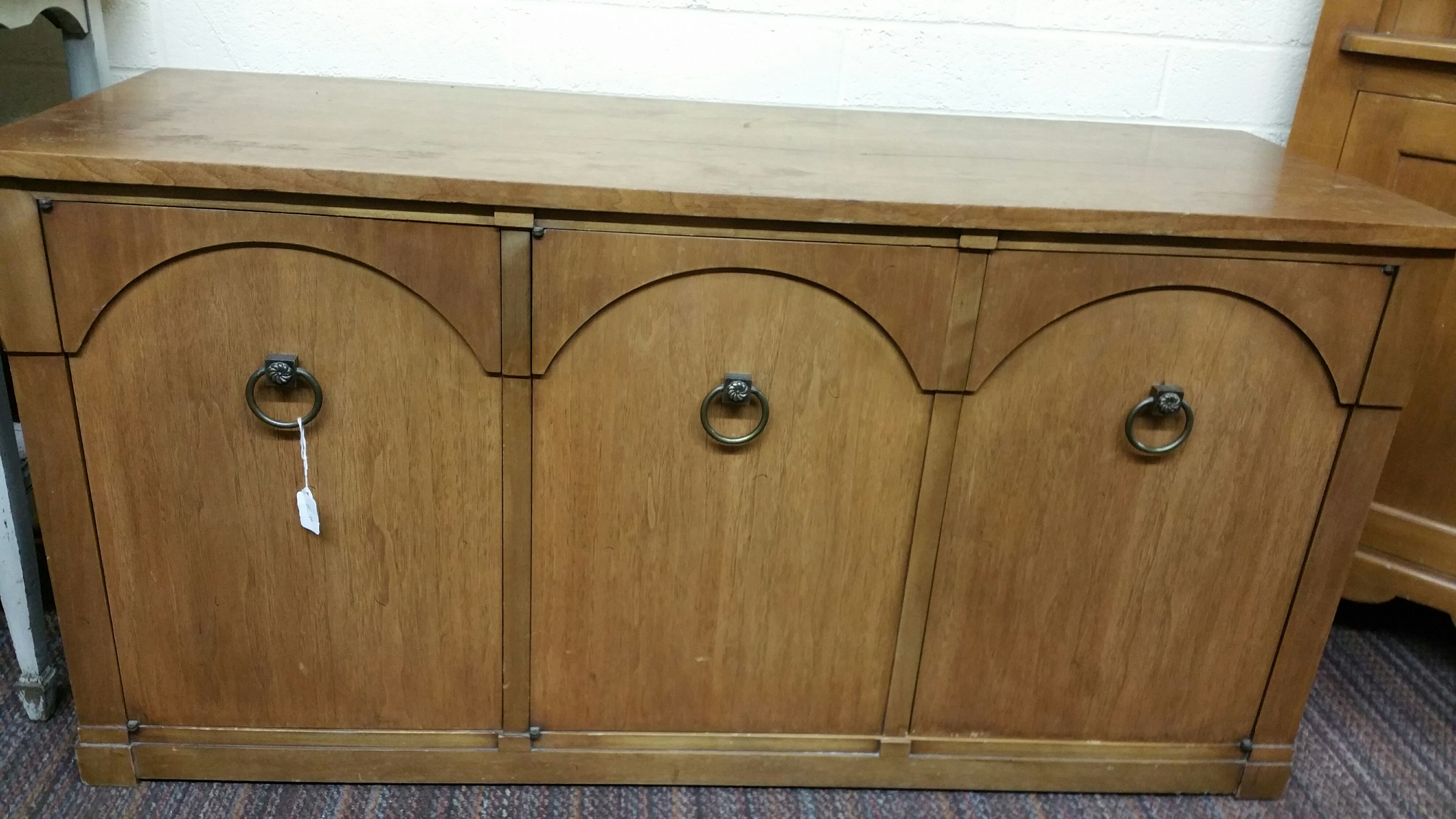 Beautiful Antique Credenza with Ring Pull Handles, right door has 3 pull out drawers. Perfect for storing your best dinnerware and flatware. Worth $400, selling for $275.