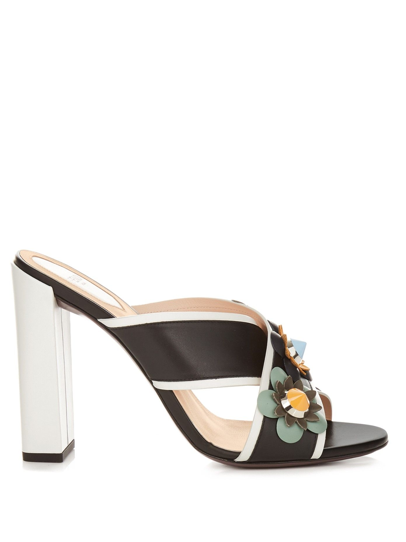 Fendi's black and white leather mules are a great showcase of the label's new Flowerland embellishment – a contemporary take on florals.