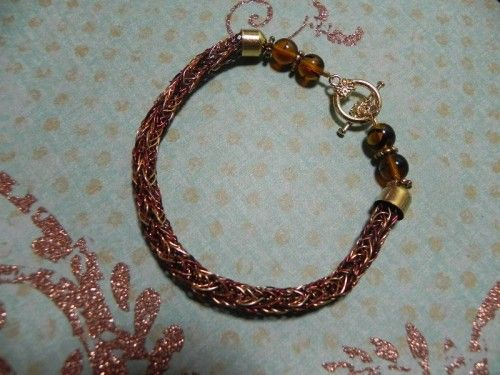 Viking knit shades of brown, copper, gold, & rust art wire with glass beads and gold tone toggle... length 8.5 inches  $20