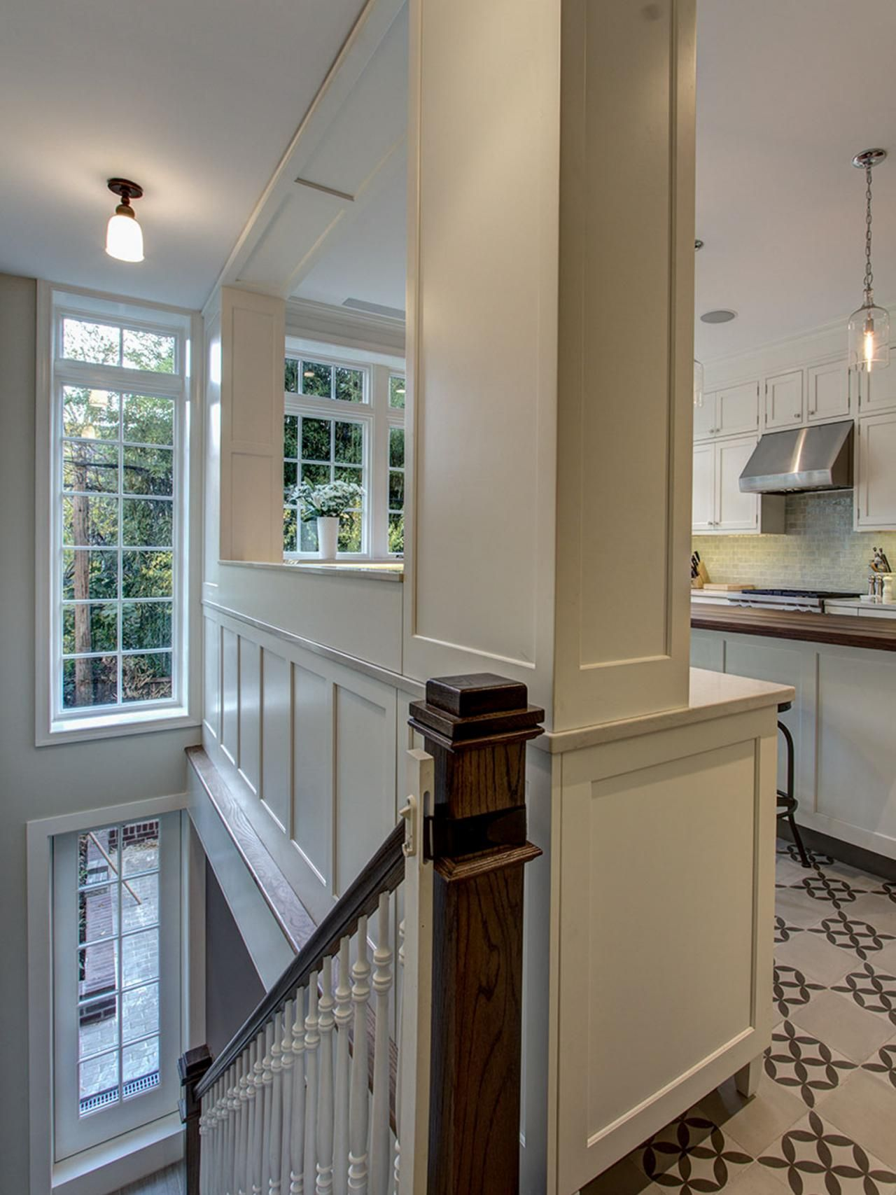Opening A Galley Kitchen Up the stairway to a lower-level family room backs up to the