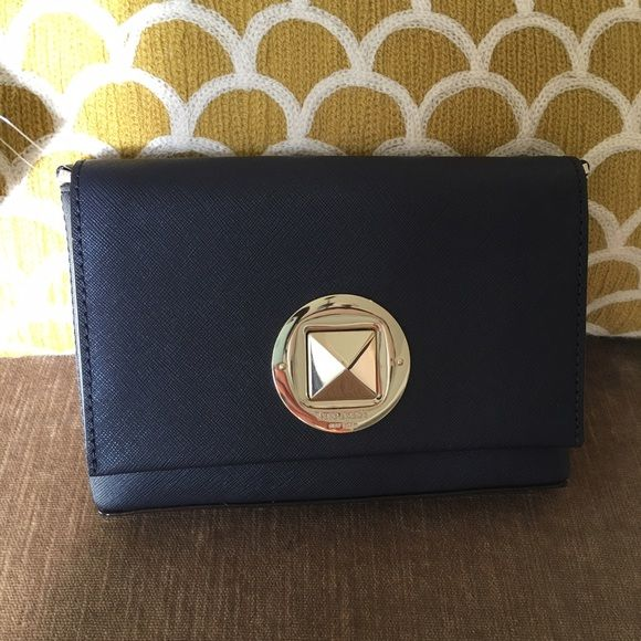 "Brand New  with tag- KS crossbody bag Color: Orbit blue Dimensions                             :  5.25""H  x  7.5""L  x  1.25""D ; Strap drop - 21""  Material: Scratch resistant Saffiano Leather Flap front secured with Kate Spade Embossed CharmTurnlock 14k Light gold-plated hardware Interior is fully lined in Kate Spade Custom Twill Interior has one multi-function pocketpls see 1st pic. Lite scratch on the hardware plate. Last one kate spade Bags"