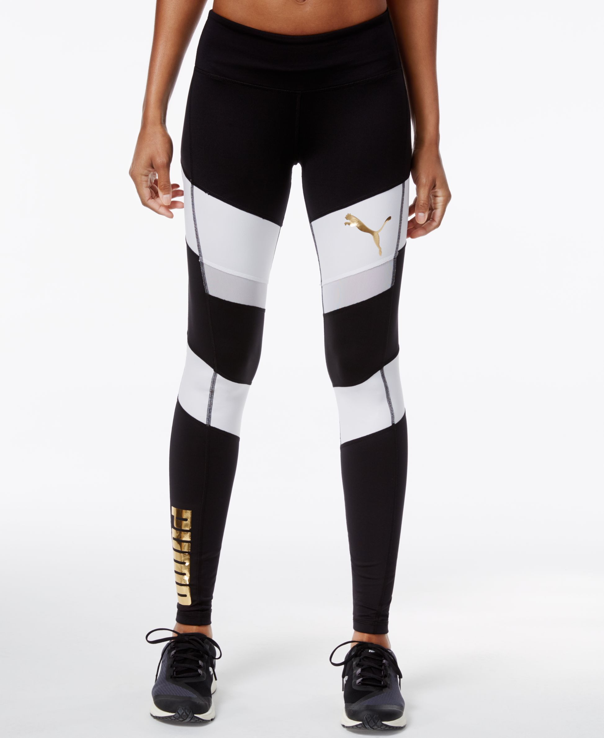 Level up your look with the flattering colorblocked design and metallic  trim of… Puma Leggings f4af8c51b