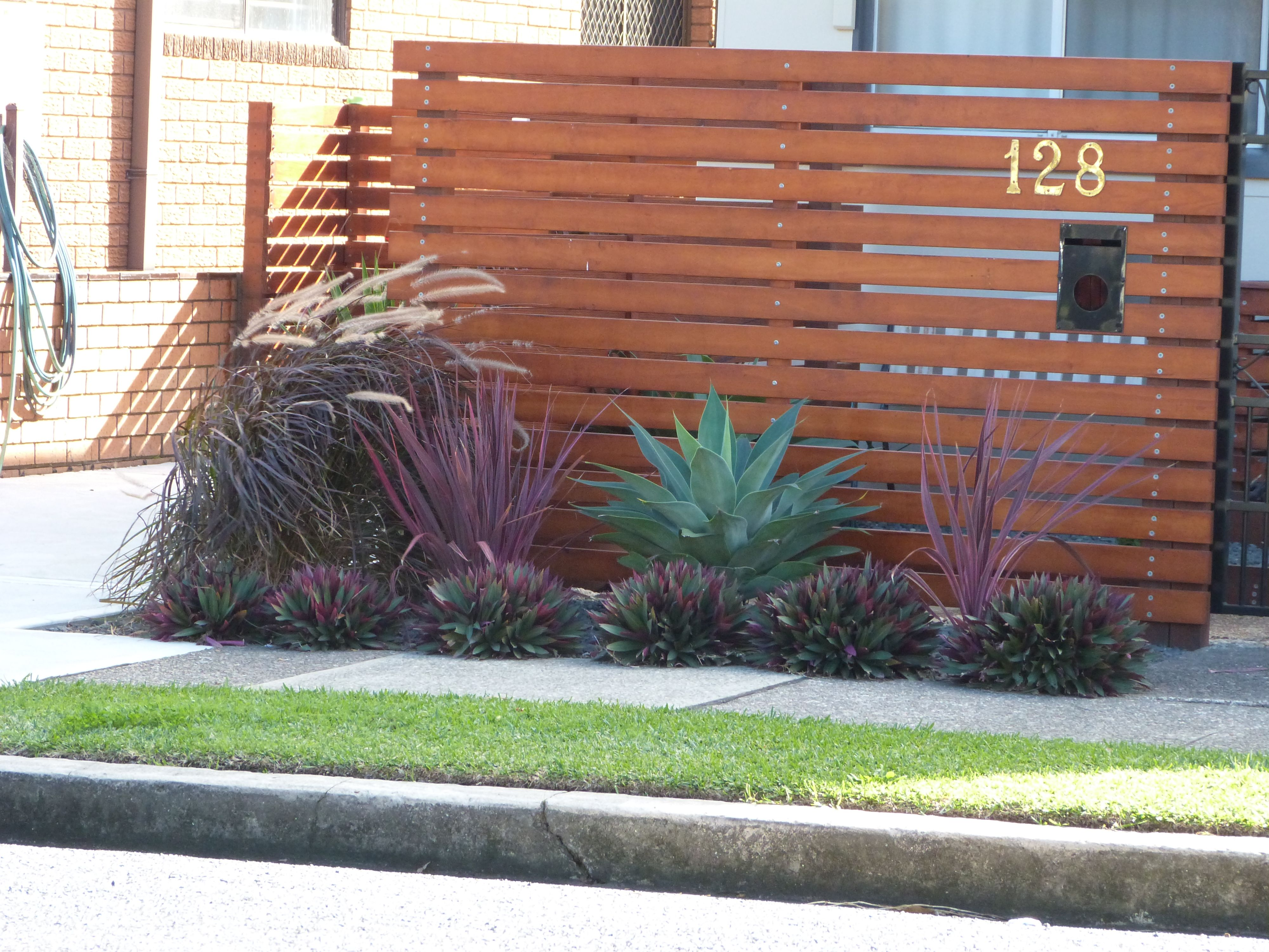 Simple Australian Landscaping Ideas Using Agave White Rocks And Ornamental Grasses For Edging