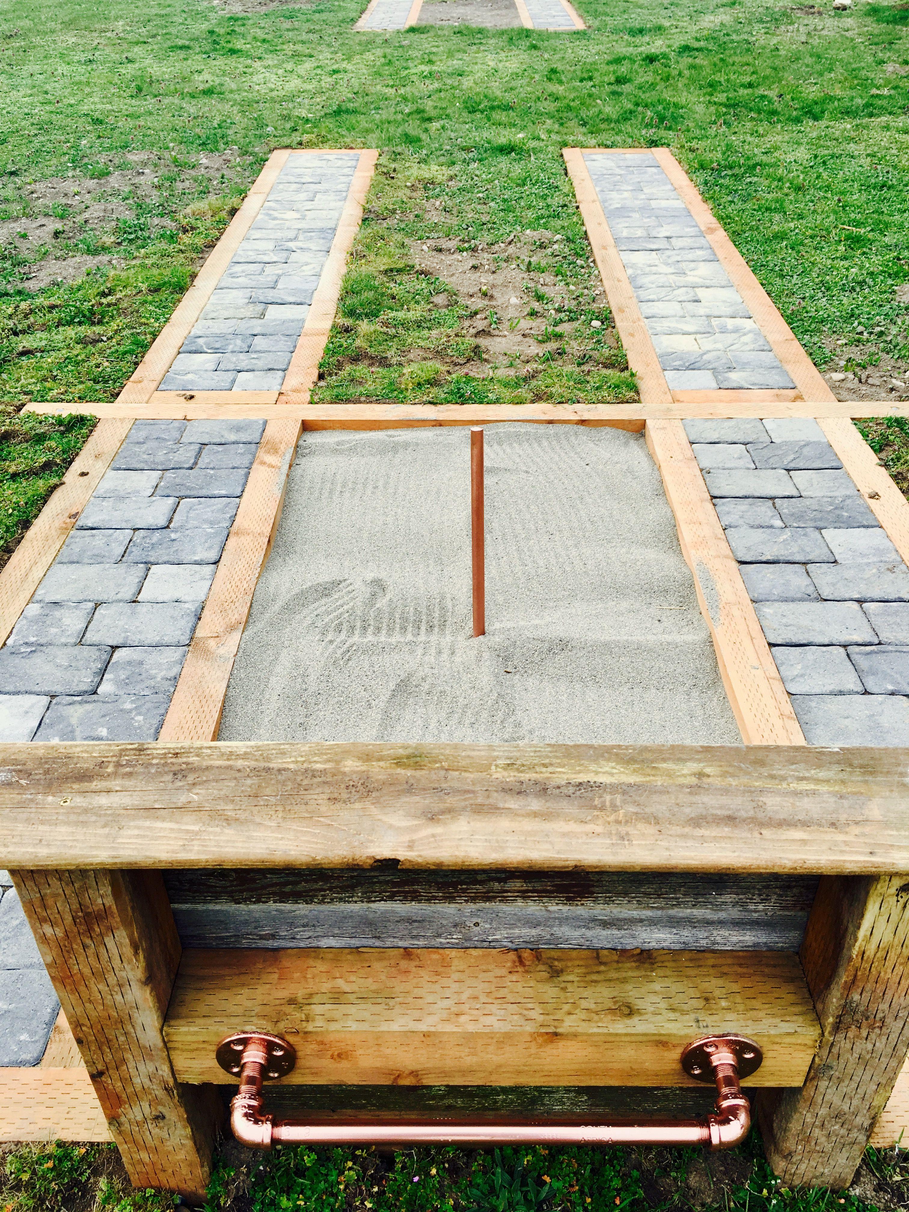 Backyard horseshoe pit!Paver walkways, recycled backstop ...