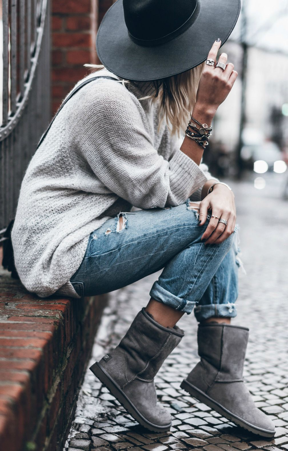 Jacqueline Mikuta+ the Ugg trend + classic pair of ankle high boots + rolled jeans + cable knit sweater + wide brimmed fedora hat + cosy + homely look + colder winter days Shoes: Ugg Australia.
