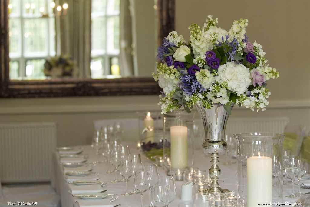 Silver Urn Table Display With White Hydrangea Purple Lisianthus Oceon Song Roses