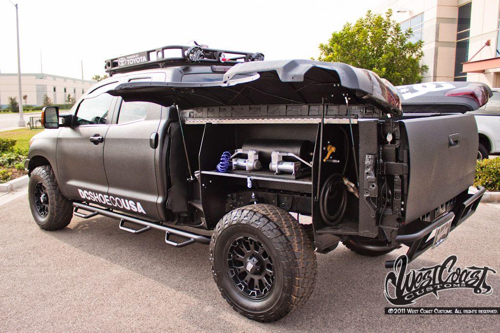 west coast customs dc shoes toyota tundra nissan navara cars trucks vehicles. Black Bedroom Furniture Sets. Home Design Ideas