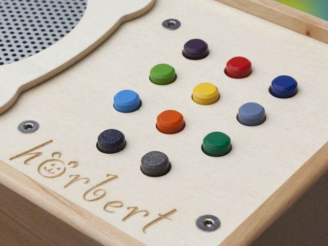 Program a song or set of songs to each button.  This is something I've been looking for, but it's too pricey for me.      I wonder if there's a way to build one myself?  Or to get an existing object to do the same thing?