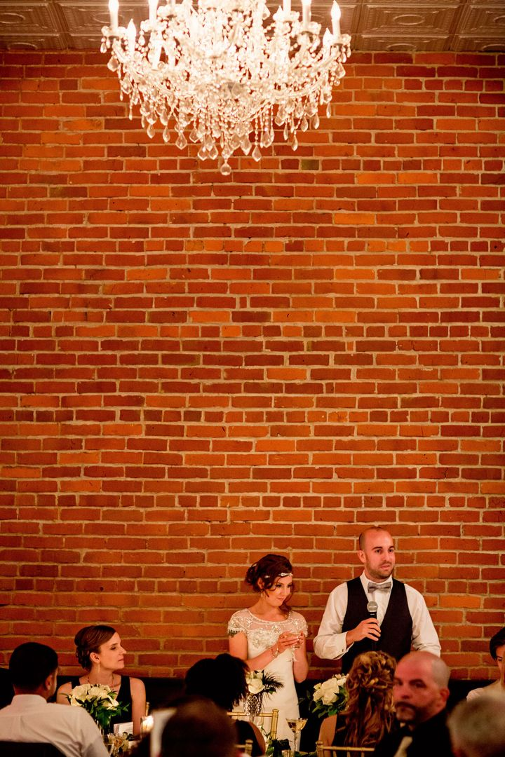 Brick background and chandeliers at wedding at the Silver Fox in Streator  www.silverfoxstreator.com/weddings.html