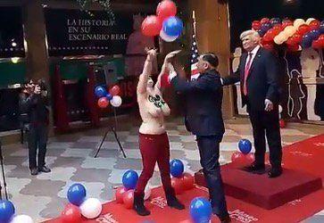 Feminista agarra por la entrepierna estatua de Trump en Madrid