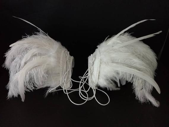We make and ship our items really fast if you need it for a specific date please let us know. or call/text us at 954-3051817 to complete your order over the phoneFeather epaulettes  Feather Carnival Set Shoulder Pieces  showgirl carnival pageant epaulets Elton John Inspired White ostrich floss feathers and cocktail feathers ( 1 pair) and other fancy feathersWhite sequined cover on a sturdy basePearl edge and cord details as shown on the life magazine cover. Easy to secure with soft elastic strap