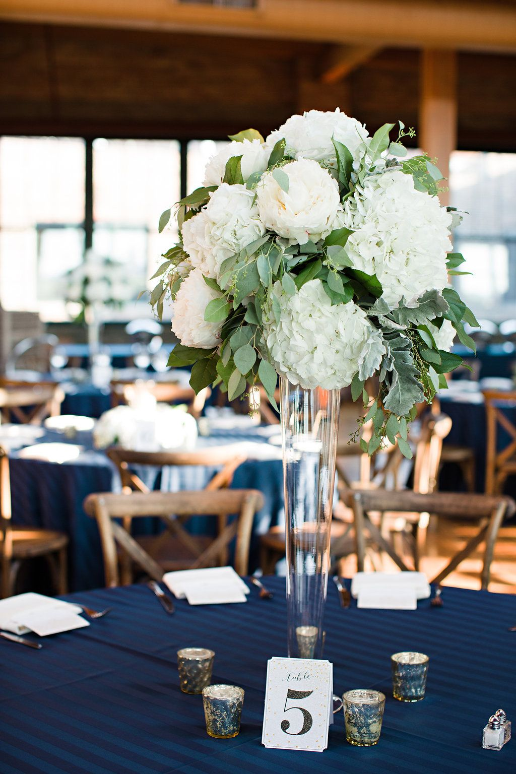 Organic green white centerpiece with peonies hydrangea
