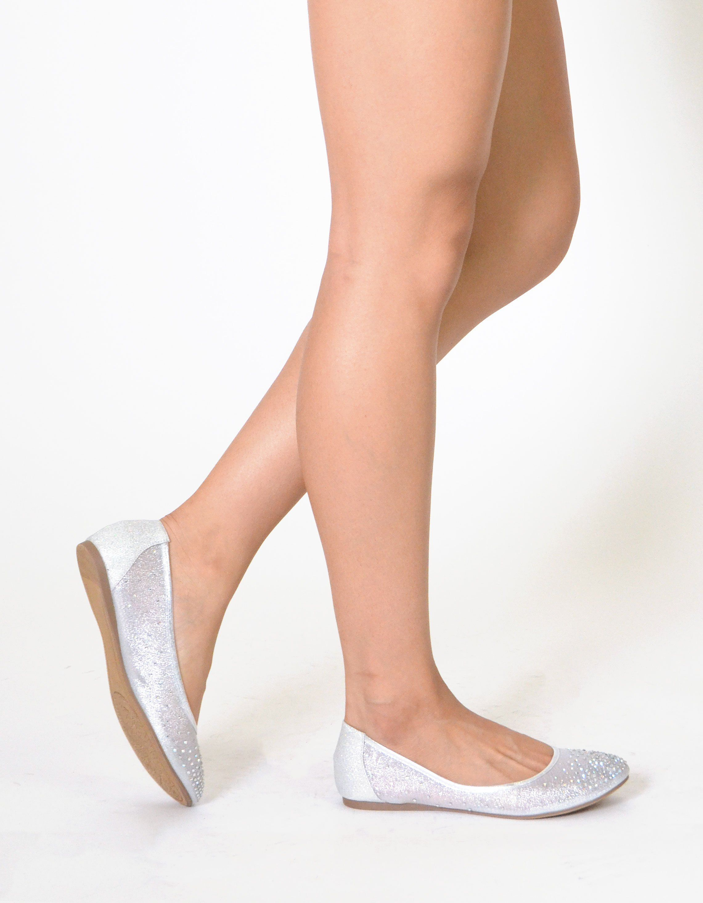 c94566ca32555 Dress up your casual wardrobe with this sophisticated ballet flat. The  rhinestone accent adds a