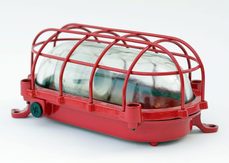 Large red 'turtle lamp' with protective cage for walls and ceilings