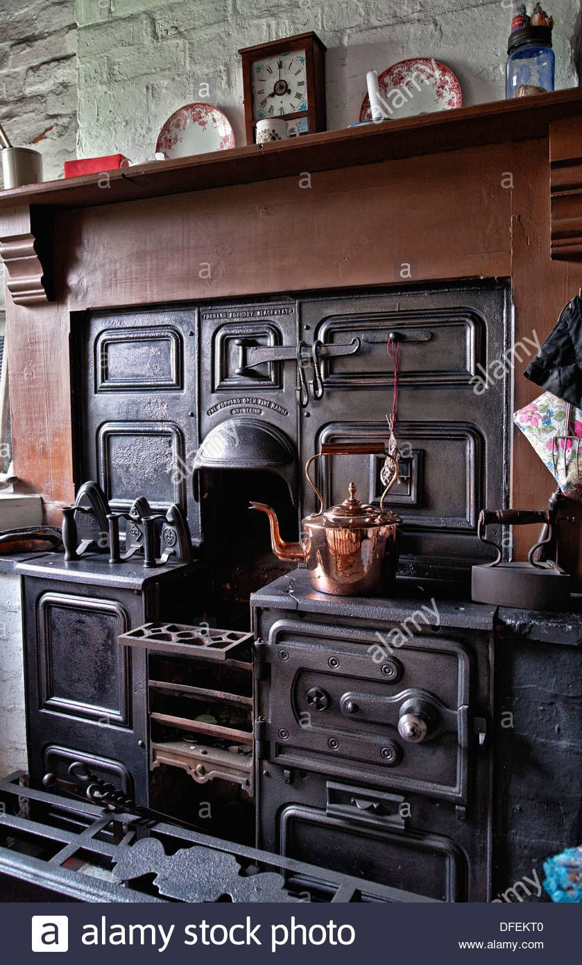 cast iron kitchen stove corner table with bench open fire cooking range from the 1800 s early 1900 black country living museum dudley west midlands england uk stock photo
