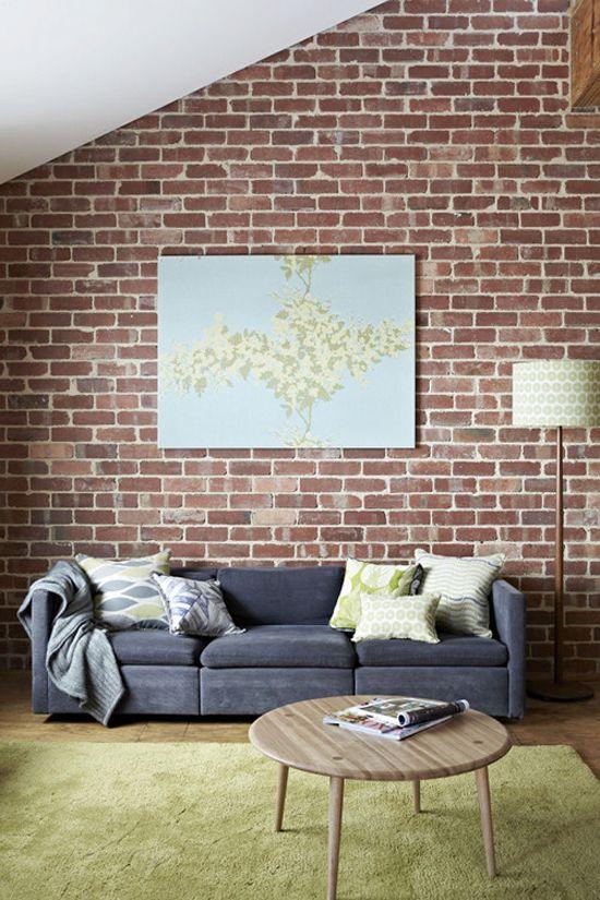 brick wall grey sofa