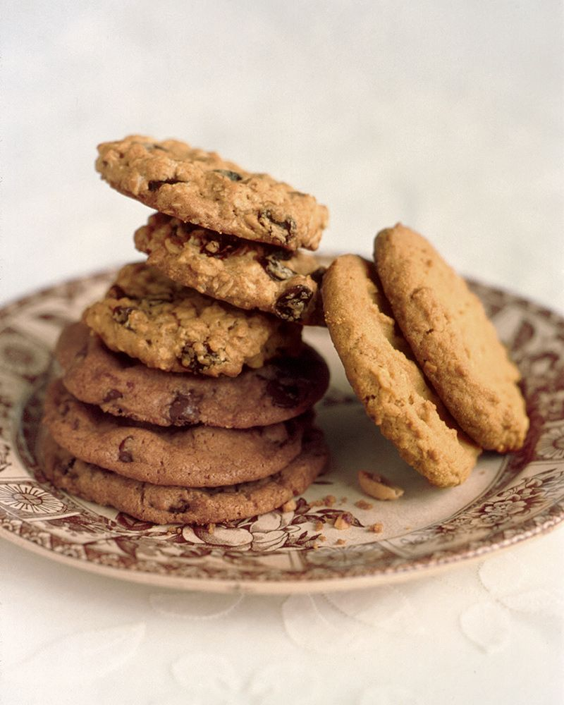 Peanut Butter Cookies | Martha Stewart - You probably have all the ingredients for these delicious peanut butter cookies on hand -- especially if you're a peanut butter fan! For extra peanut butter flavor, sprinkle cookies with salted peanuts before popping them in the oven. Substitute smooth peanut butter for chunky to get a different cookie texture.  #easydessert #quickcookies #peanutbutter