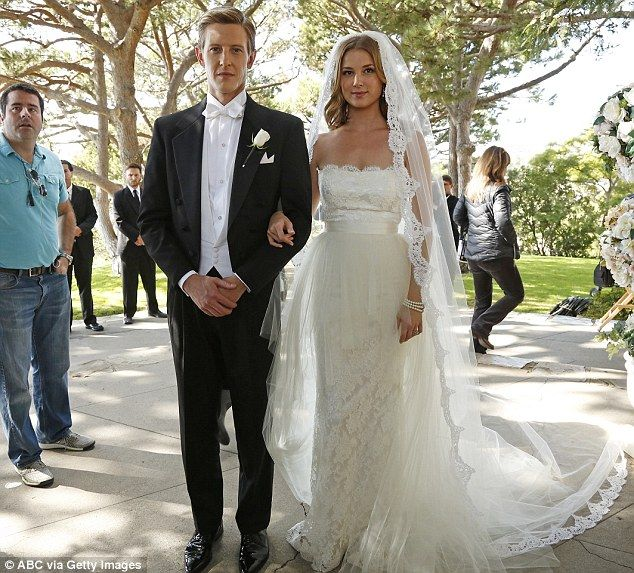 Walking the walk: Emily is walked down the aisle by best man Nolan, played by Gabriel Mann