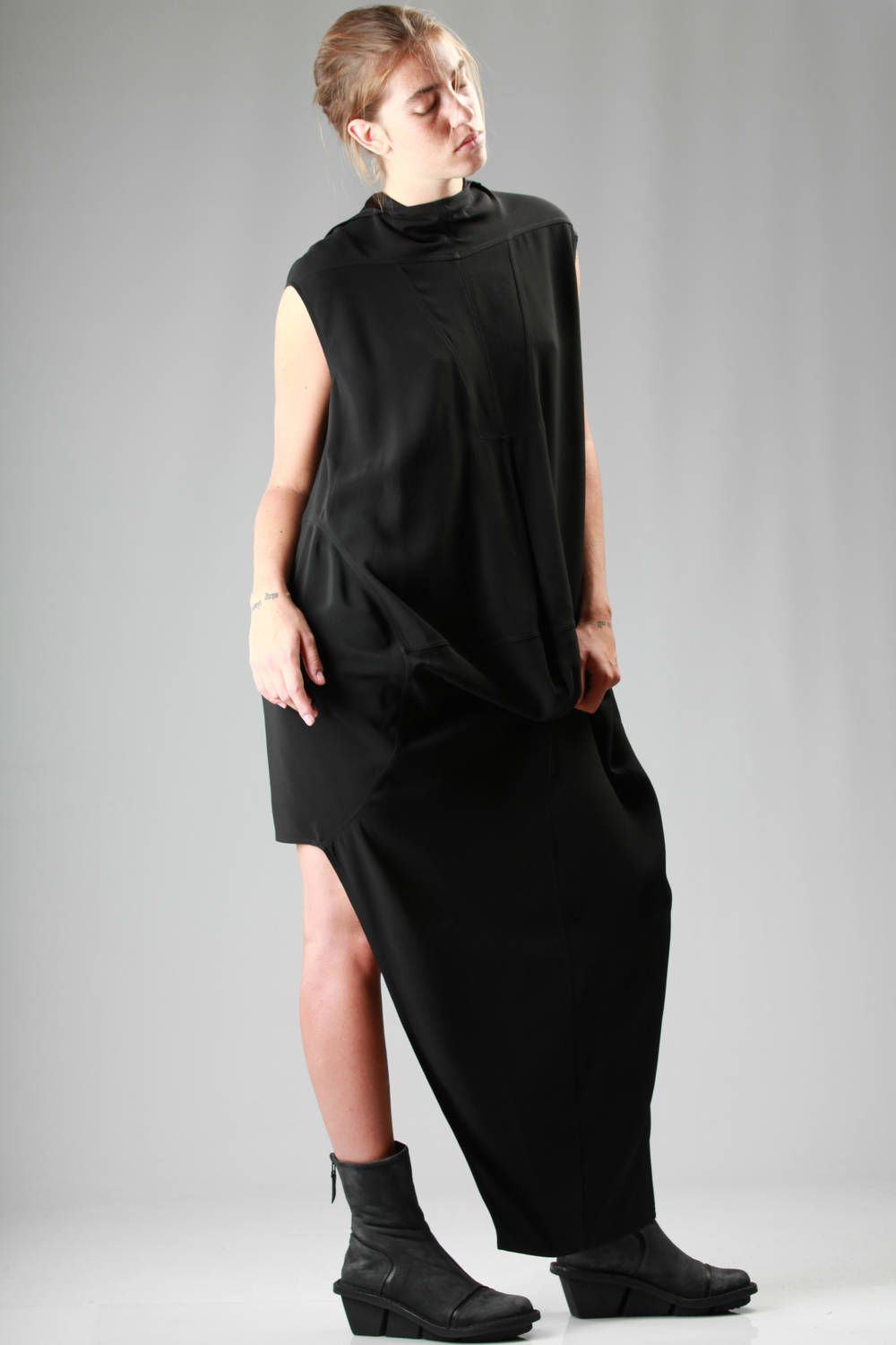 Rick Owens | 'runway' dress longer on the front and shorter on the back in viscose and acetate crêpe | 'runway' dress longer on the front and shorter on the back in viscose and acetate crêpe, flared sleeve, cowl neck, wide central front draping, geometrical stitching on the front, back closure with press buttons and wide lapels | article code: 24270 | season: Autumn/Winter | composition: 50% acetate - 50% viscose