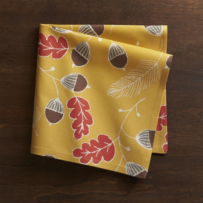 Whimsically Rendered Acorns Scatter Fall Colors On Yellow Cotton